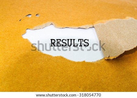 Results text on brown envelope  - stock photo