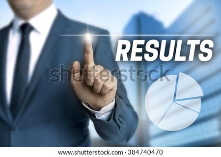 results touchscreen is operated by businessman.
