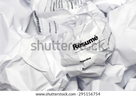 Resume in trash. Picture of resume crumpled up and thrown away in the trash. - stock photo