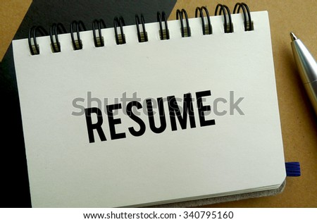 Resume memo written on a notebook with pen - stock photo