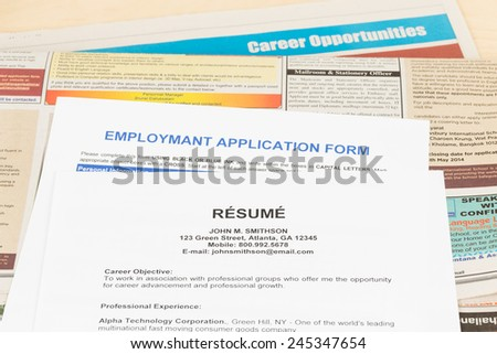 Resume on classify newspaper concept job applying - stock photo