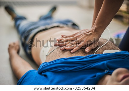 Resuscitation and cardiac massage - stock photo
