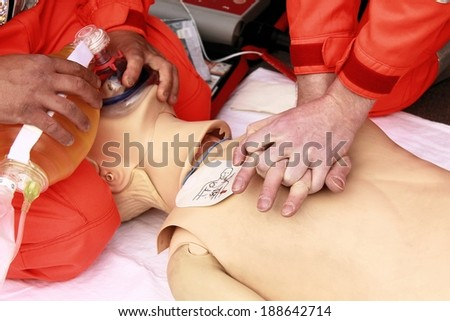 resuscitation performed by health care professionals to dummy - stock photo