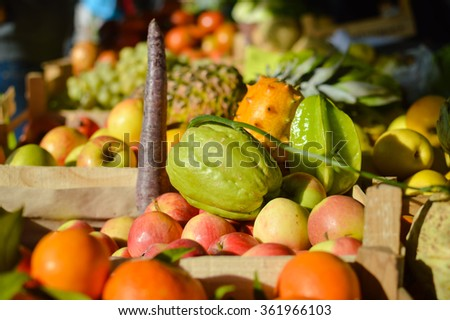 Retail business concept. Many different fruits on farmers market background.