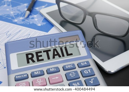 RETAIL CONCEPT Calculator  on table with Office Supplies. ipad - stock photo