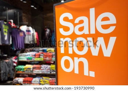 Retail image of a Sale Sign in a boutique - stock photo