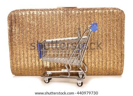 Retail therapy shopping trolley and handbag cutout - stock photo