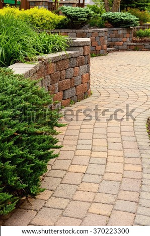 Retaining Wall and Patio with Landscaping and Pavers - stock photo