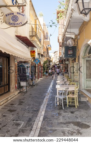 RETHYMNO, GREECE - SEPTEMBER 13. Tourists in Taverns and Gift Shops in the narrow streets of the old town in Rethymno on September 13, 2014. Rethymno is nice city with a old venetian harbor on Crete - stock photo