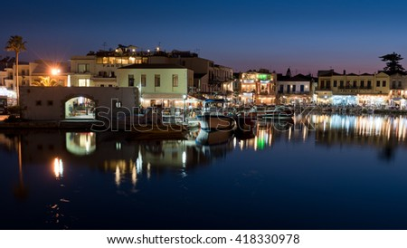 RETHYMNON, GREECE - SEPTEMBER 4; 2015. The venetian harbor of Retymno. Lots of restaurants at the pier. The venetian harbor in Retymno is a main attraction on Crete