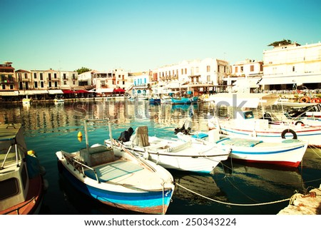 Rethymnon old city center with boats in sea bay, impressions of Greece - stock photo