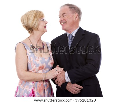 retired couple dressed up on white isolated background - stock photo