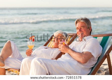 Retired couple drinking a cocktail