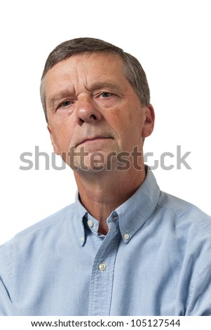 Retired executive looks pensively towards the camera and isolated against white