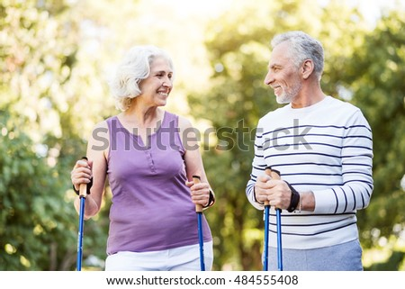 Retired man and woman smiling at each other in love