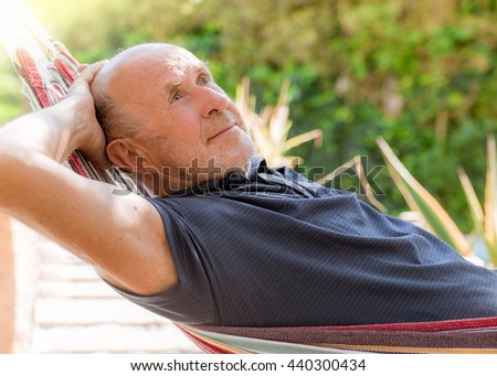 retired man lying down relaxed - stock photo