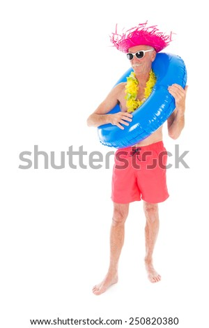 Retired man on vacation with toys isolated over white background