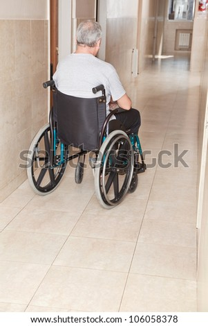 Retired man on wheelchair at hospital. - stock photo