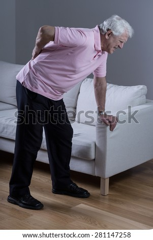 Retired man with sciatica spasm - stock photo