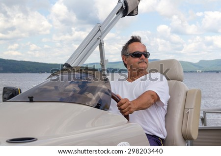 retired mature men driving a pontoon boat on a lake at daytime
