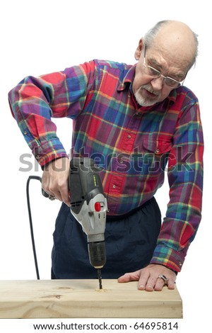 Retired senior citizen uses an electric drill to put a hole in wood