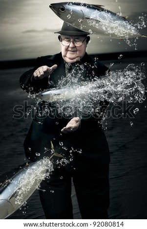 Retired Senior Man Wearing Suit And Tie Standing By A River Trying To Catch Jumping Tuna Fish In A Metaphor For The One That Got Away - stock photo