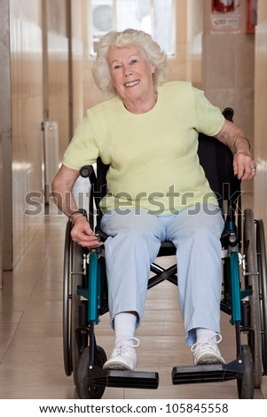 Retired woman on wheelchair at hospital. - stock photo