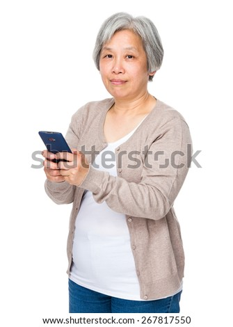 Retired woman use of mobile phone - stock photo