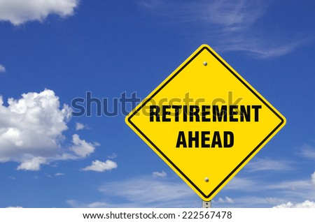 Retirement Ahead Sign against Blue Sky - stock photo