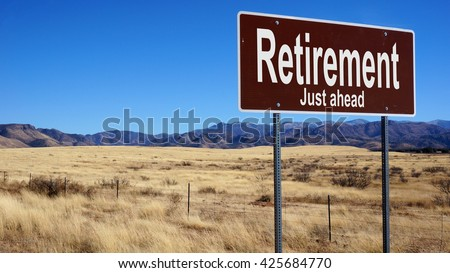 Retirement brown road sign with blue sky and wilderness - stock photo