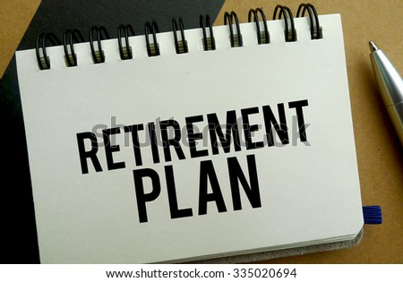 Retirement plan memo written on a notebook with pen
