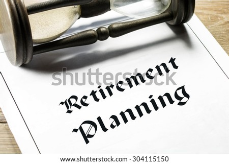 Retirement planning concept with hourglass in the background.