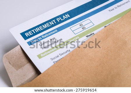 Retirement Planning letter in brown envelope opening, business concept - stock photo