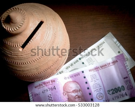 Retirement Savings, coin bank. Indian Currency, with new 500 Indian rupee currency, published on November 9.