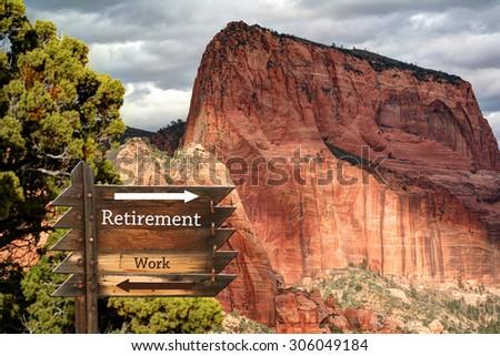 Retirement verses Work on weathered wooden slats against Kolob mountain backdrop - stock photo