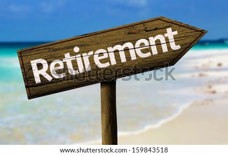 Retirement wooden sign with a beach on background - stock photo