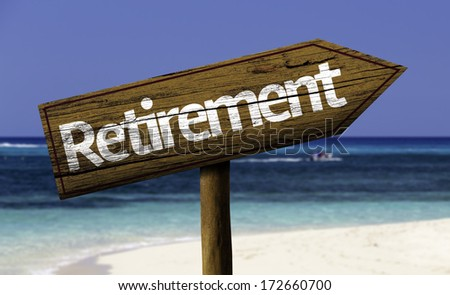 Retirement wooden sign with the beach on background - stock photo