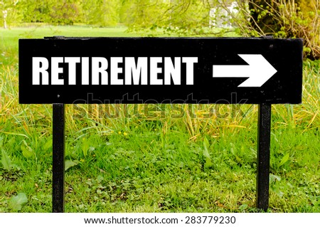 RETIREMENT written on directional black metal sign with arrow pointing to the right against natural green background. Concept image with available copy space - stock photo