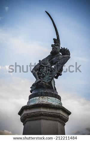 retiro, devil figure, bronze sculpture with demonic gargoyles and monsters - stock photo