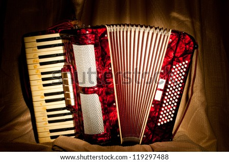 Retro accordion in the dark - stock photo