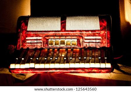 Retro accordion in the dark - stock photo