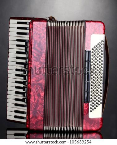 Retro accordion on grey background - stock photo