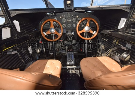 Retro airplane cockpit interior view - stock photo