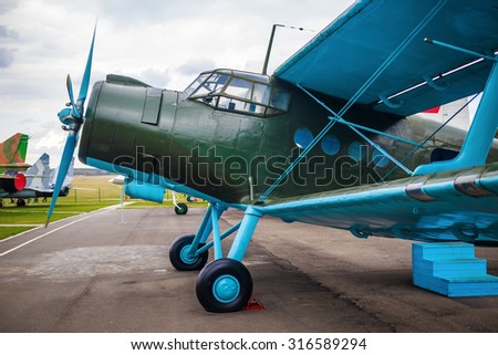 Retro airplane. Old vintage single-engined biplane closeup. - stock photo