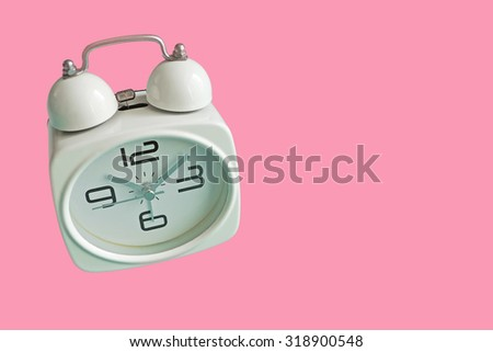 Retro alarm clock isolated on pink background with copy space. Retro style. - stock photo
