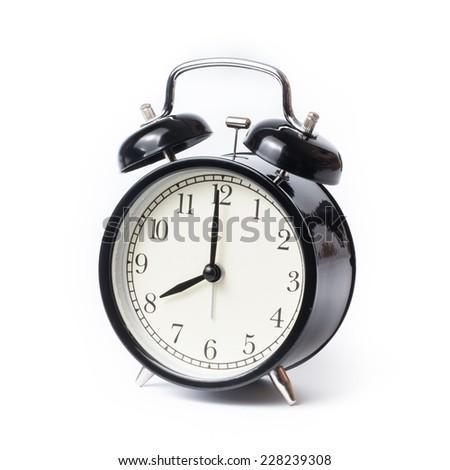 Retro alarm clock on isolated white background - stock photo