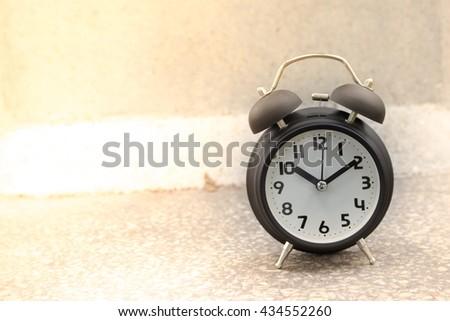 retro alarm clock on table - stock photo