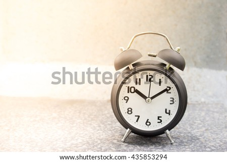 retro alarm clock on table,Paste the text into the space left. - stock photo