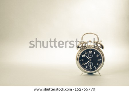 Retro alarm clock photo for vintage sepia background - stock photo