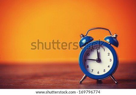 Retro alarm clock. Photo in retro color image style